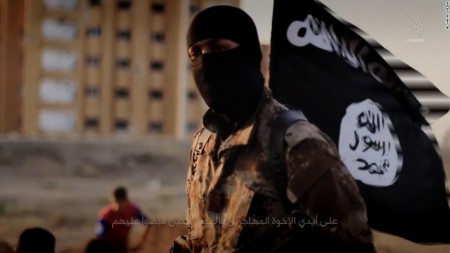 141117103601-isis-masked-militant-flag-horizontal-large-gallery