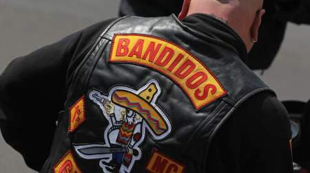BERLIN, GERMANY - JUNE 24:  A member of the Bandidos motorcycle gang sits on his motorcycle outside the Bandidos Berlin Eastgate club on June 24, 2011 in Berlin, Germany. Both the Berlin City and Berlin Eastgate Bandidos clubs are celebrating their 10th anniversary over the weekend. The Bandidos and their rivals, the Hell's Angels, often make headlines in Germany due to alleged criminal activities of the two groups, including murder, assault and extortion.  (Photo by Sean Gallup/Getty Images)