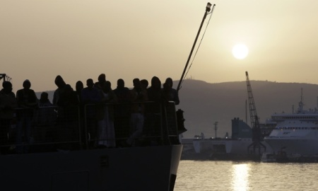 Migrants wait to disembark from the Iceland Coast Guard vessel Tyr, at the Messina harbor, Sicily, southern Italy, Wednesday, May 6, 2015. The weekend saw a dramatic increase in rescues as smugglers in Libya took advantage of calm seas and warm weather to send thousands of would-be refugees out into the Mediterranean in overloaded rubber boats and fishing vessels. The coast guard reported that nearly 7,000 people were rescued in the three days ending Sunday. (AP Photo/Antonio Calanni)