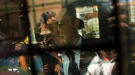South African Olympic and Paralympic sprinter Oscar Pistorius is seen in a police van after his sentencing at the North Gauteng High Court in Pretoria October 21, 2014. Pistorius was sentenced to five years in prison on Tuesday for killing his girlfriend Reeva Steenkamp, ending a trial that has gripped South Africa and the world. REUTERS/Siphiwe Sibeko (SOUTH AFRICA - Tags: SPORT ATHLETICS CRIME LAW)